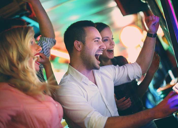 people gambling in slot tournament