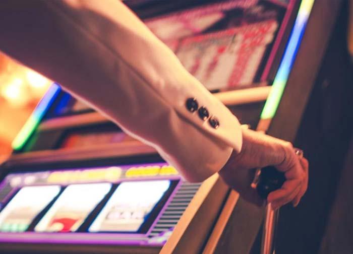 Person playing slot machine